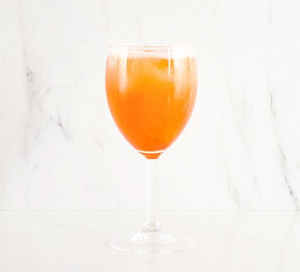 Aperitivo spritz served in a wine glass