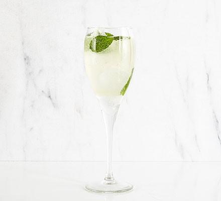 Champagne mojito served in a wine glass