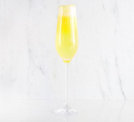 Mango bellini served in a champagne flute