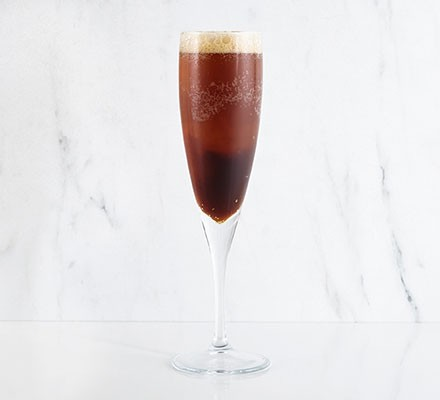 Porter & champagne served in a champagne glass