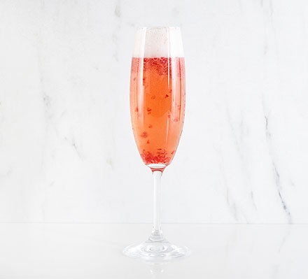 Raspberry fizz served in a champagne flute