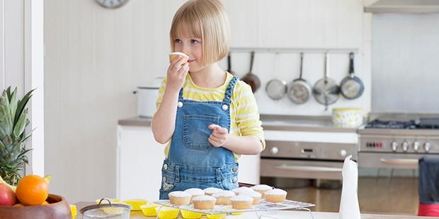 Child smelling cupcake