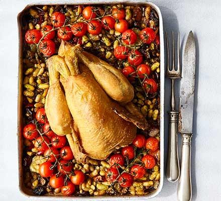 Summer roast chicken traybake served in a roasting tin