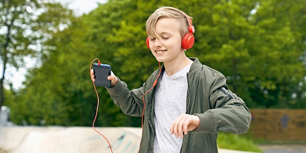Boy listening to music outside