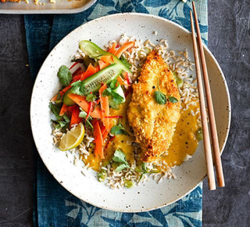 Plate with katsu curry served over rice with a side salad