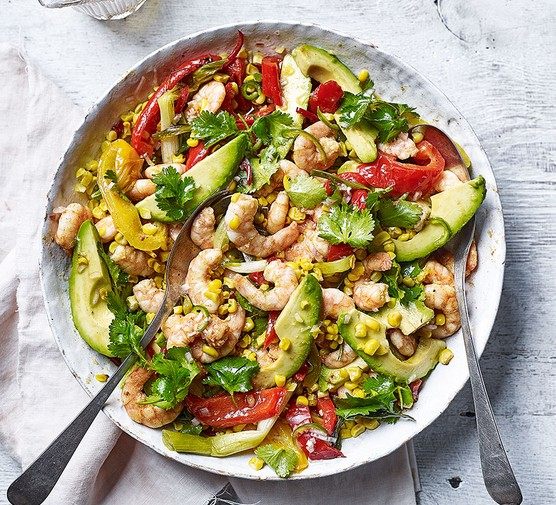 Roast corn, prawn, pepper and avocado salad served in a bowl