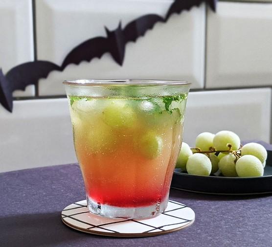 Ghoulish grape, apple & grenadine cooler mocktail served in a tumbler glass