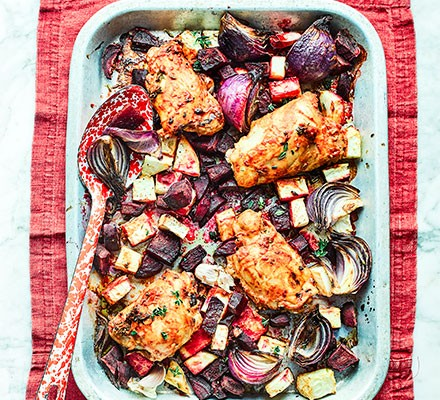 All-in–one chicken with wilted spinach served in a casserole dish