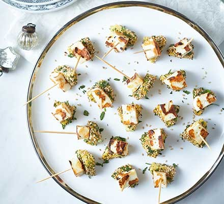 Cheese & pineapple canapés served on a plate
