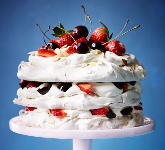 Amaretto meringue cake with strawberries & cherries