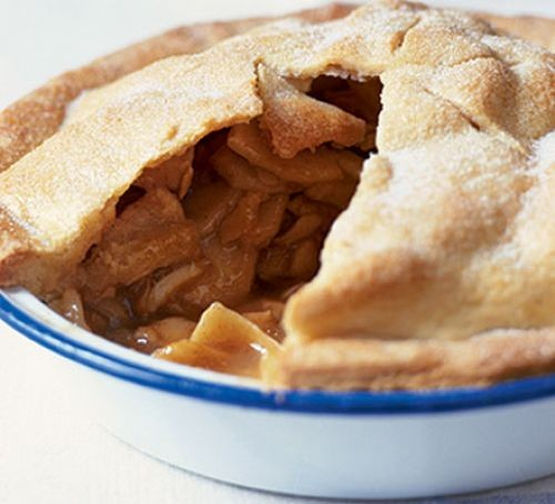 Apple pie with slice taken out