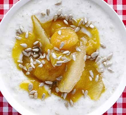 Creamy yogurt porridge with apricot, ginger & grapefruit topping