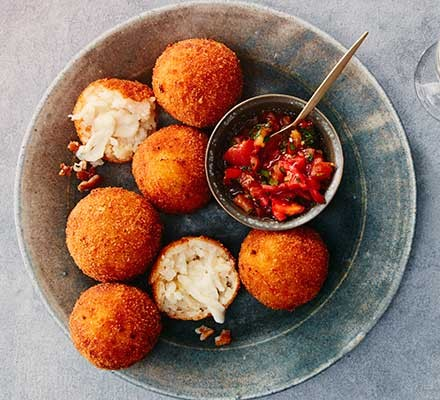Arancini balls served with a dip