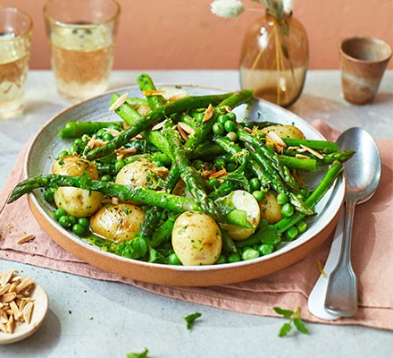 Asparagus with peas, mint & Jersey Royals in wild garlic butter