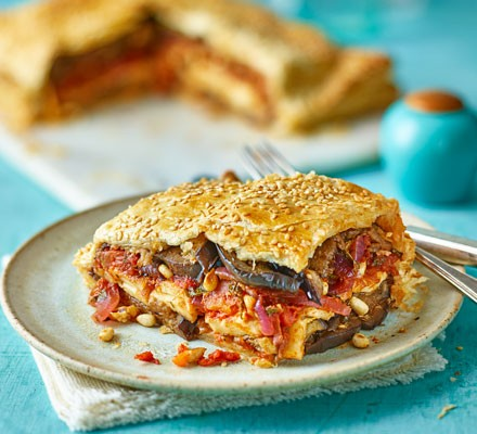 Slice of layered veggie pie on plate