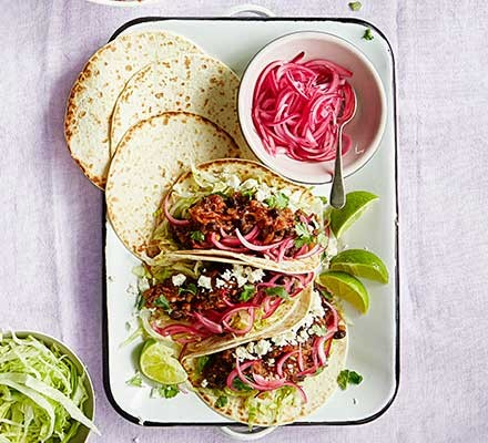 Smoky pulled aubergine & black bean tacos in a dish