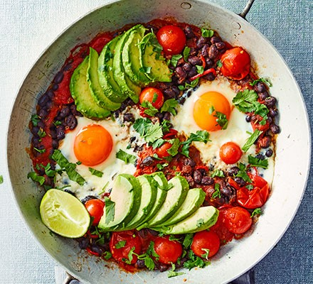 Avocado & black bean eggs in a bowl