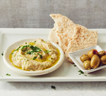 Baba ganoush dip with olives and pitta