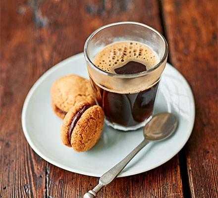 Baci di dama served with a shot of espresso