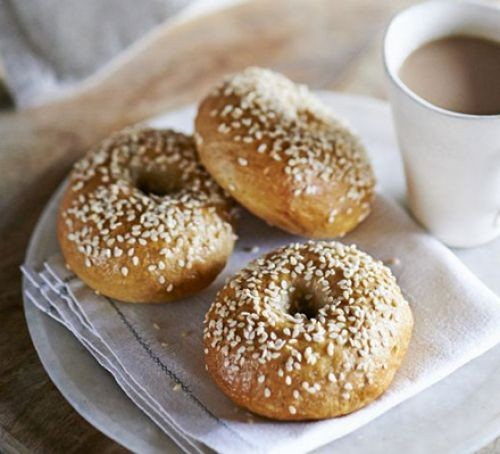 Three bagels topped with sesame seeds