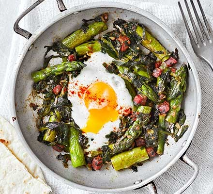 Spicy asparagus & chorizo baked egg served in a bowl