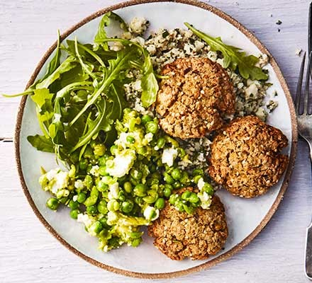Baked falafel & cauliflower tabbouleh with avocado, pea & feta smash served on a plate