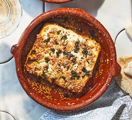 Baked feta with sesame & honey served in a small terracotta dish