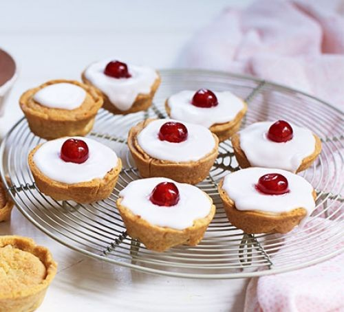 Cherry bakewell tarts on a wire tray