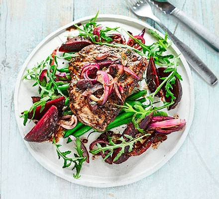A plate serving balsamic beef with beetroot & rocket