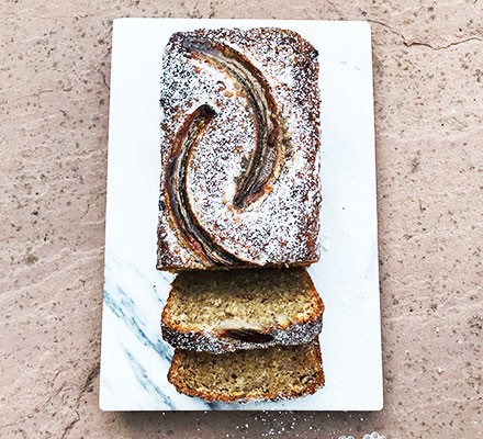 Gluten-free banana bread with slices cut out