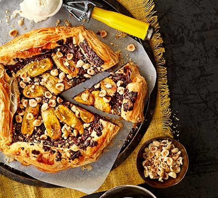 Caramelised banana & chocolate galette with a slice cut out