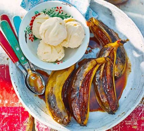 Caramelised BBQ bananas in rum sauce with ice cream scoops