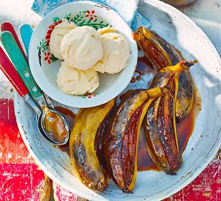 Four barbecued bananas served with ice-cream