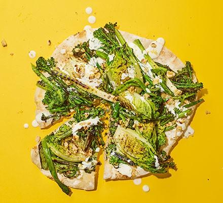 BBQ salad pizza cut into pieces