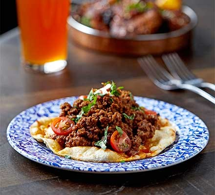 A plate serving beef dripping keema naan