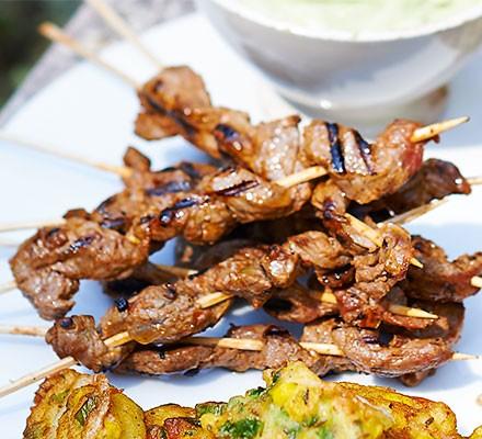 Harissa beef skewers with avocado dip