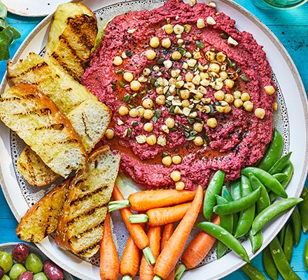 Beetroot hummus party platter served with vegetables and toast