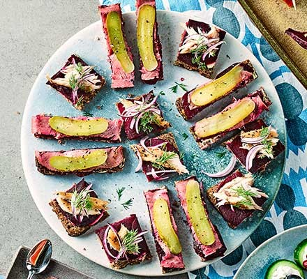 Beetroot & rye tartines served on a large plate
