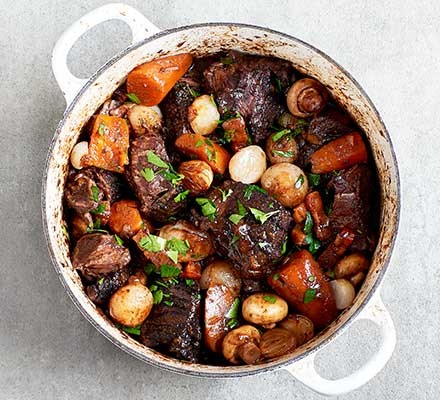 Beef bourguinon served in a casserole dish