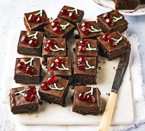 Black Forest brownies with cherry design icing