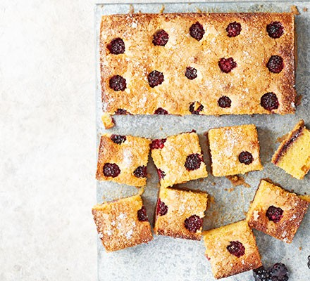 Blackberry bakewell squares on a chopping board