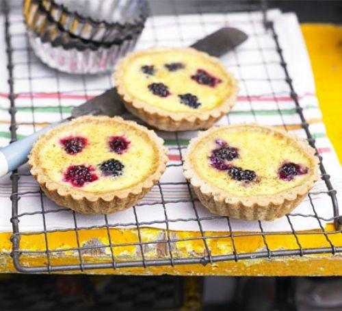 blackberry custard tarts on a cooling rack