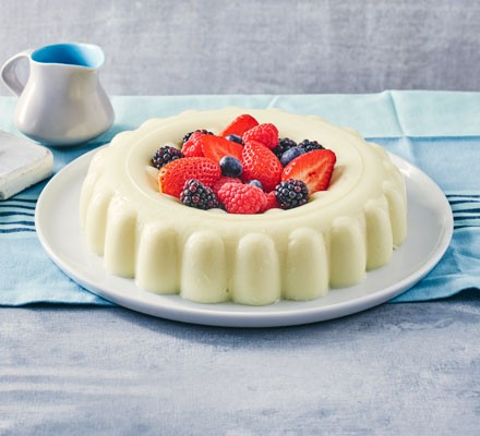 Blancmange with berries on plate