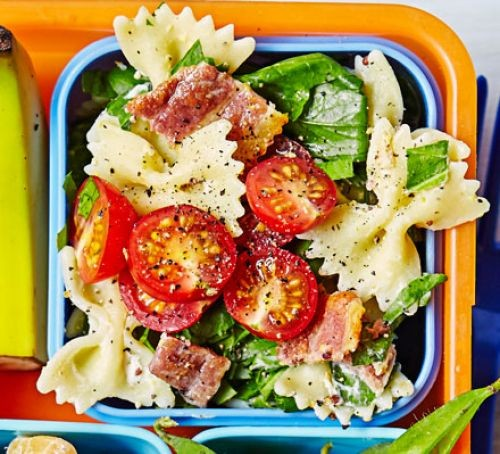 Bacon, lettuce, tomato and farfalle pasta salad in a lunchbox