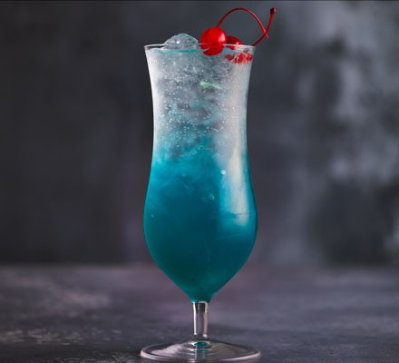 Blue cocktail with cherries