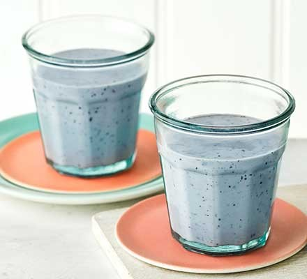 Two glasses of blueberry & banana power smoothie