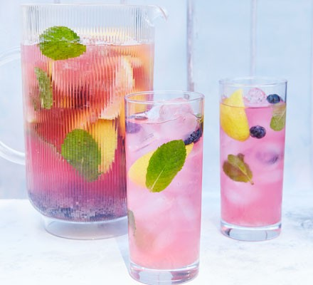 Blueberry mojito with mint in glasses and jug