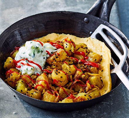Bombay potato omelette served in a frying pan