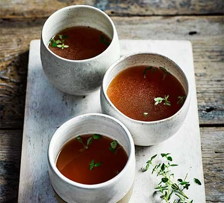 Three cups filled with slow cooker bone broth