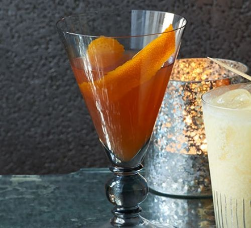 Bourbon cocktail in a glass with orange peel
